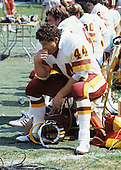 Washington Redskins running back John Riggins (44) rests on the bench during the game against the Kansas City Chiefs at RFK Stadium in Washington, D.C. on September 19, 1983..Credit: Arnie Sachs / CNP
