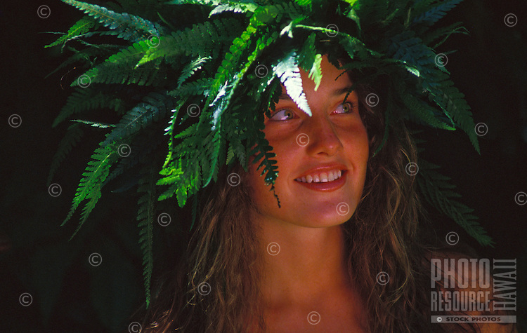 Woman (Paige) with palapalai fern head lei.