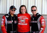 Sep 29, 2013; Madison, IL, USA; NHRA top fuel dragster driver Billy Torrence (left) and his son Steve Torrence (right) pose for a picture with a fan during the Midwest Nationals at Gateway Motorsports Park. Mandatory Credit: Mark J. Rebilas-