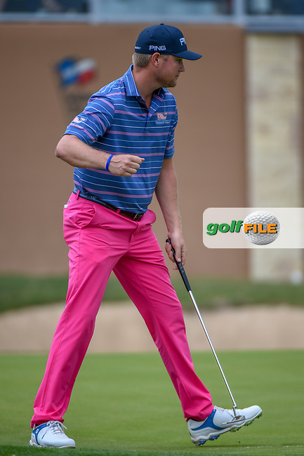Trey Mullinax (USA) gives a celebratory fist bump after sinking his birdie putt on 18 and setting a new course record of 62  during Round 3 of the Valero Texas Open, AT&T Oaks Course, TPC San Antonio, San Antonio, Texas, USA. 4/21/2018.<br /> Picture: Golffile | Ken Murray<br /> <br /> <br /> All photo usage must carry mandatory copyright credit (© Golffile | Ken Murray)