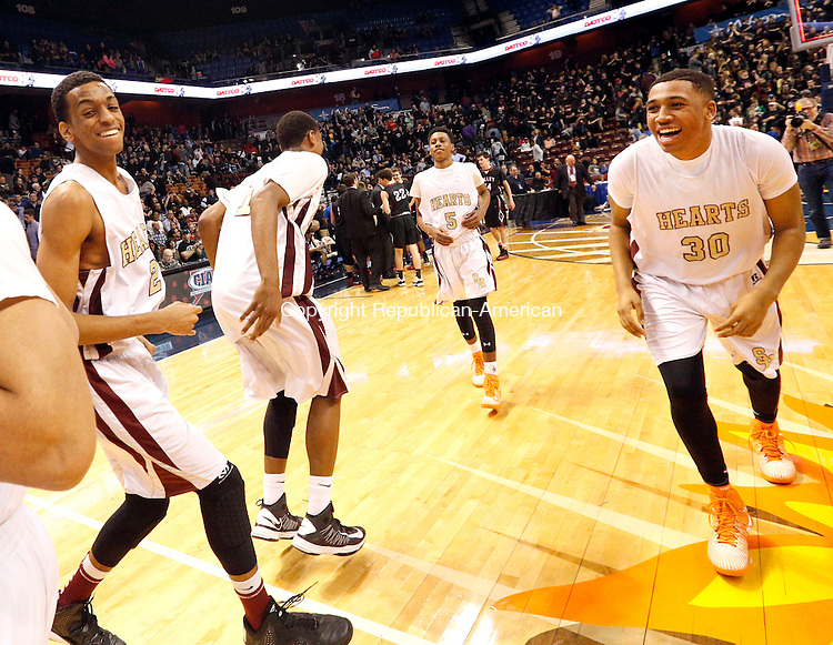 Uncasville, CT- 22 March 2015-032215CM31- Sacred Heart's Isaiah Rascoe (30) and John Riddick, left, celebrate after the Hearts defeated Valley Regional in Class S state championship game at Mohegan Sun Arena in Uncasville on Sunday. The Hearts won, 71-46.    Christopher Massa Republican-American