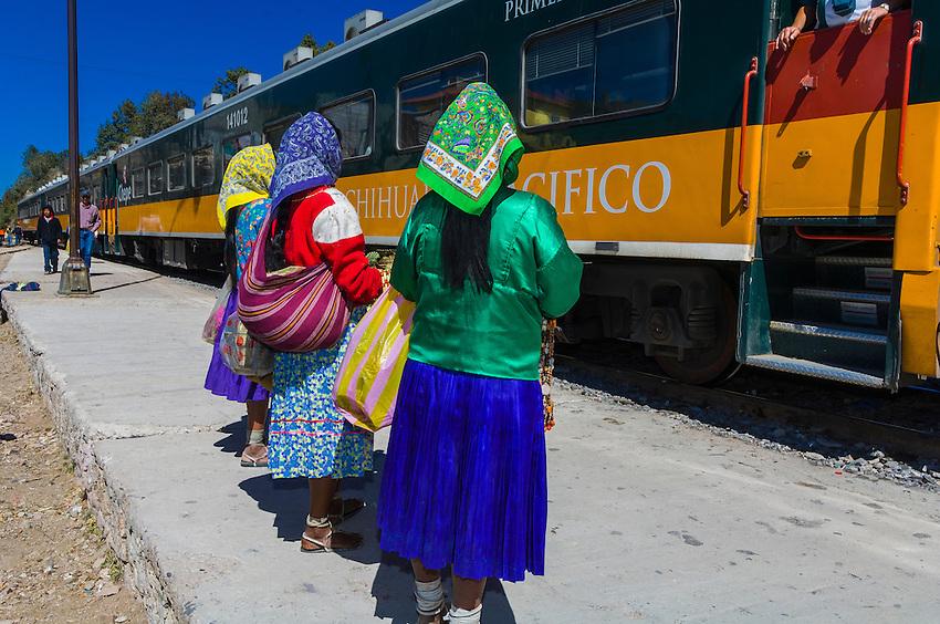 Tarahumara women selling handwoven baskets, The Chihuahua al Pacifico railroad (Chepe) train at San Rafael, Copper Canyon, Mexico