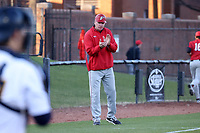 GREENSBORO, NC - FEBRUARY 25: Head coach Bill Currier stands in the third base coaching box during a game between Fairfield and UNC Greensboro at UNCG Baseball Stadium on February 25, 2020 in Greensboro, North Carolina.