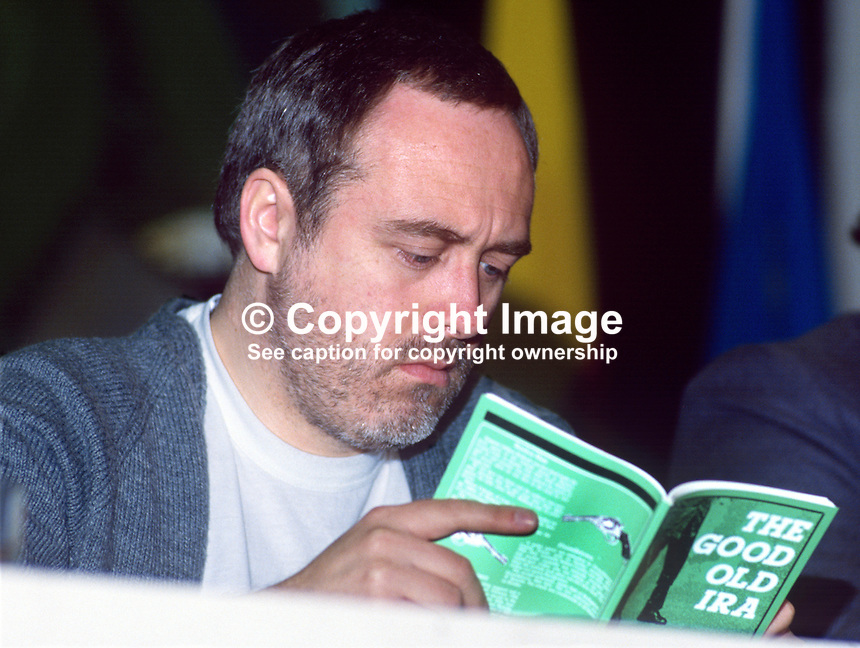 Danny Morrison, Provisonal Sinn Fein, assemblyman, Mid-Ulster, N Ireland, on the platform, Ard Fheis, Dublin, 1985, reads a book, The Good OLd IRA. 19851102DM2..Copyright Image from Victor Patterson, 54 Dorchester Park, Belfast, UK, BT9 6RJ..Tel: +44 28 9066 1296.Mob: +44 7802 353836.Voicemail +44 20 8816 7153.Skype: victorpattersonbelfast.Email: victorpatterson@me.com.Email: victorpatterson@ireland.com (back-up)..IMPORTANT: If you wish to use this image or any other of my images please go to www.victorpatterson.com and click on the Terms & Conditions. Then contact me by email or phone with the reference number(s) of the image(s) concerned.