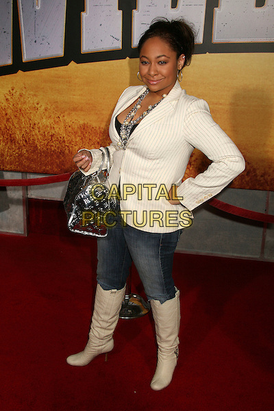 "RAVEN SIMONE .""Wild Hogs"" Los Angeles Premiere at the El Capitan Theatre, Hollywood, California, USA..February 27th, 2007.full length jeans denim tucked into cream boots white pinstripe suit jacket hand on hip silver bag purse .CAP/ADM/BP.©Byron Purvis/AdMedia/Capital Pictures"