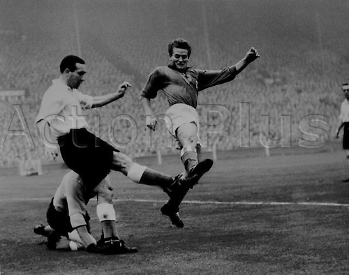 21.10.1953. Wembley, England. Rest of the World versus England. Alf Ramsey clears the ball from Gianpiero Boniperti (Rest of the World) during the match at Wembley stadium. 21st October 1953