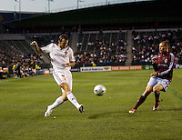 LA Galaxy defender Chris Klein (7) sends a ball over the middle past  Colorado Rapids midfielder Colin Clark (23). The Colorado Rapids defeated the LA Galaxy 1-0 during the preliminary rounds of the 2008 US Open Cup at Home Depot Center stadium in Carson, Calif., on Tuesday, May 27, 2008.