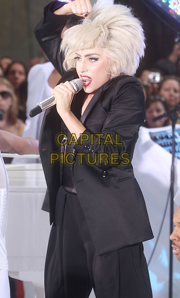 "LADY GAGA (Stefani Joanne Angelina Germanotta) .performs live on NBC's ""TODAY"" Show at Rockefeller Center, New York, NY, USA, 9th July 2010..on stage music concert gig half length black jacket blazer microphone singing suit hand wig hair funny  .CAP/ADM/AC.©Alex Cole/AdMedia/Capital Pictures."