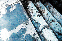 Footprints are tracked through water puddles along steps next to a pool in Russellville, Arkansas.