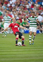 July 16, 2010 Paul Scholes No. 18 of Manchester United and Marc Crosas No. 17 of Celtic FC during an international friendly between Manchester United and Celtic FC at the Rogers Centre in Toronto.