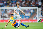 Luka Modric (r) of Real Madrid fights for the ball with Daniel Parejo Munoz of Valencia CF during their La Liga 2017-18 match between Real Madrid and Valencia CF at the Estadio Santiago Bernabeu on 27 August 2017 in Madrid, Spain. Photo by Diego Gonzalez / Power Sport Images