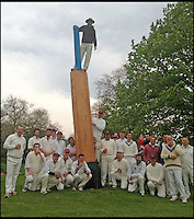 BNPS.co.uk (01202 558833)<br /> Pic: SteveJones/BNPS                                <br /> <br /> Shobrooke Park Cricket Club with the large bat.<br /> <br /> A village cricket club has turned a beloved tree that has stood on the boundary of their ground for 125 years into a giant carving of a cricket bat after it was condemned.<br /> <br /> The 16ft tall wooden bat took a tree surgeon and an assistant 18 months to carve after members of Shobrooke Park Cricket Club couldn't bring themselves fell the storm-damaged Scots Pine.<br /> <br /> The tree was planted on the eastern edge of the boundary when the club in Crediton, Devon, was established in 1890 and has been a feature ever since.