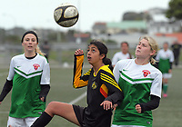 Action from the Women's Capital Division One football match between Island Bay United Flames (black and yellow) and Wairarapa United 2nds at Wakefield Park in Wellington, New Zealand on Sunday, 28 May 2017. Photo: Dave Lintott / lintottphoto.co.nz