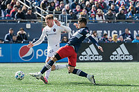 FOXBOROUGH, MA - MARCH 7: Gustavo Bou #7 of New England Revolution tackles Djordje Mihailovic #14 of Chicago Fire during a game between Chicago Fire and New England Revolution at Gillette Stadium on March 7, 2020 in Foxborough, Massachusetts.