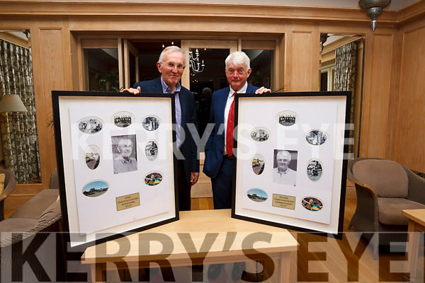 Joe Moriarty (left) and John O'Callaghan receiving a framed momento on their retirement from KerryAgri