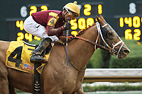 HOT SPRINGS, AR - March 11: Whitmore #4, ridden by Ricardo Santana, Jr., wins the Hot Springs Stakes at Oaklawn Park on March 11, 2017 in Hot Springs, AR. (Photo by Ciara Bowen/Eclipse Sportswire/Getty Images)