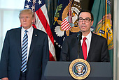 United States Secretary of the Treasury Steven Mnuchin makes remarks as US President Donald J. Trump looks on prior to the President signing three Executive Orders concerning financial services at the Department of the Treasury in Washington, DC on April 21, 2017.<br /> Credit: Ron Sachs / Pool via CNP
