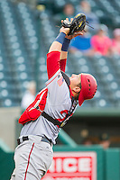 Hagerstown Suns catcher Spencer Kieboom (20) settles under a foul pop fly behind home plate during the game against the Greensboro Grasshoppers at NewBridge Bank Park on May 20, 2014 in Greensboro, North Carolina.  The Grasshoppers defeated the Suns 5-4. (Brian Westerholt/Four Seam Images)