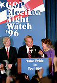 Former United States Senator Bob Dole (Republican of Kansas), the 1996 Republican Party candidate for President of the United States, makes his concession speech to supporters at an Election Night Party sponsored by the Republican National Committee at the Renaissance Hotel in Washington, DC on Tuesday, November 5, 1996.  Pictured from left to right: US Senator John McCain (Republican of Arizona), Mr. Dole, and wife Elizabeth Dole.<br /> Credit: Ron Sachs / CNP