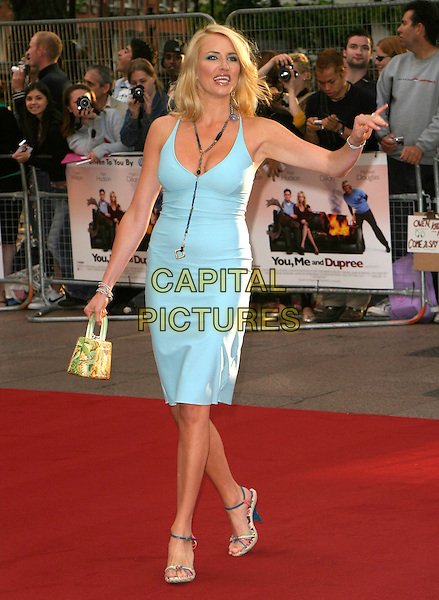 "NANCY SORRELL .At the UK Film Premiere of ""You, Me & Dupree"",.Odeon Leicester Square, London, England, .August 22nd 2006..full length blue dress grey long y necklace bag hand waving arm.Ref: AH.www.capitalpictures.com.sales@capitalpictures.com.©Adam Houghton/Capital Pictures."