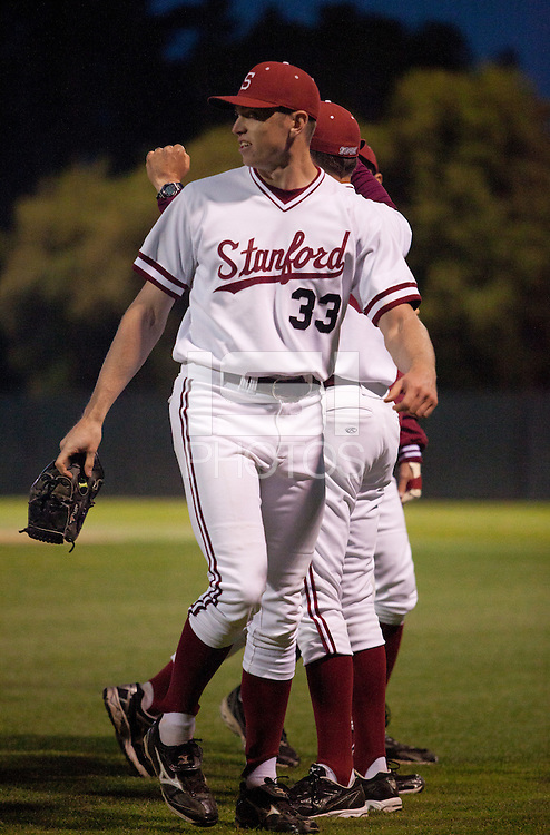 STANFORD, CA - April 12, 2011: Chris Reed of Stanford baseball looks back to the mound after closing the game during Stanford's game against Pacific at Sunken Diamond. Stanford won 3-1.