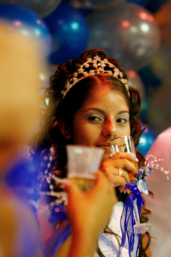 "Elizabeth drinks sparkling cider with her damas and chambelanes during a toast to honor her during the reception. ""I feel different today, like a woman,"" says Ureña."