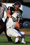 ROME, GA - DECEMBER 18: Dominic Studzinski #42 of the University of Sioux Falls wraps up John Camino #1 of Carroll College in the first quarter at Barron Stadium in the 2010 NAIA National Football Championship in Rome, GA.(photo by Dave Eggen/Inertia)