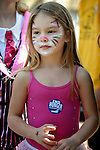 A young participant had her face painted before the CROP Hunger Walk, held October 27, 2013, in Raleigh, North Carolina.