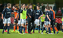 Dundee manager Paul Hartley and players  at the end of the game.