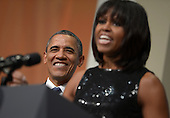 United States President Barack Obama listens as First Lady Michelle Obama delivers remarks at the Inaugural Reception at the National Building Museum in Washington, DC, USA, 20 January 2013. Obama defeated Republican candidate Mitt Romney on Election Day 06 November 2012 to be re-elected for a second term..Credit: Shawn Thew / Pool via CNP