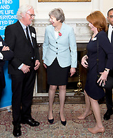 30 October 2017 - Prime Minister Theresa May with Billy Connolly and Jane Asher at a reception at 10 Downing Street in London, marking 200 years since Dr James Parkinson's Essay on the Shaking Palsy. Photo Credit: ALPR/AdMedia
