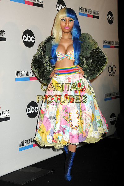 Nicki Minaj.2011 American Music Awards Nominee Press Conference held at the JW Marriott LA Live Hotel, Los Angeles, California, USA..October 11th, 2011.full length green jacket seaweed cabbage food cropped top bra bathing suit cleavage green skirt belly stomach midriff blue blonde hair dyed print floral black boots hands on hips.CAP/ADM/BP.©Byron Purvis/AdMedia/Capital Pictures.