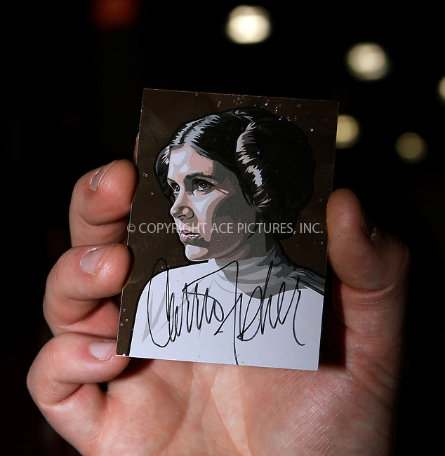 WWW.ACEPIXS.COM....October 13 2012, New York City....Carrie Fisher card and autograph at the 2012 New York Comic Con at the Javits Center on October 13, 2012 in New York City....By Line: Nancy Rivera/ACE Pictures......ACE Pictures, Inc...tel: 646 769 0430..Email: info@acepixs.com..www.acepixs.com
