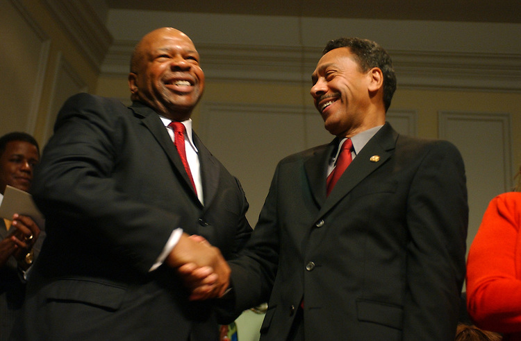 Outing CBC Chairman Elijah Cummings, D-Md., left, shaked hands with incoming chairman Mel Watt, D-N.C., at a Congressional Black Caucus ceremony at the Library of Congress, in which members where sworn into the CBC for the109th Congress,Tuesday.