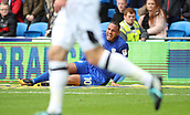 30th September 2017, Cardiff City Stadium, Cardiff, Wales; EFL Championship football, Cardiff City versus Derby County; Kenneth Zohore of Cardiff City grimaces in pain holding his hamstring but continues shortly after
