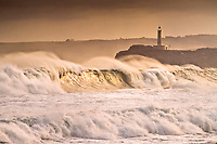 lighthouse in storm, Mouro Island, Santander, Cantabria, Spain