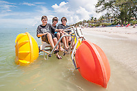 Rob Bradley, 12, Nolan Starkey, 14, and Brett Bradley, 10, on an oversized watersport bike from Bonita Jetski & Parasail at Doc's Beach House on Bonita Beach, Florida. Photo by Debi Pittman Wilkey.