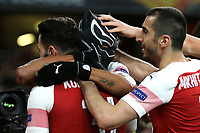 Arsenal players congratulate Pierre-Emerick Aubameyang wearing the mask, after scoring their third goal during Arsenal vs Rennes, UEFA Europa League Football at the Emirates Stadium on 14th March 2019