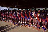Gorotire, Xingu, Brazil. Kayapo women in dance ceremony wearing red and blue beads, black genipapo and red urucum body paint.