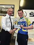 Chairperson of Drogheda Wheelers Superintendent Andrew Watters presents Ben McCourt Lenihan with his prize as 1st unplaced A3 rider in the Coombes Connor Memorial race. Photo:Colin Bell/pressphotos.ie