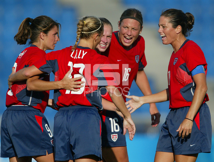 20 August 2004:  Kristine Lilly celebrates with Mia Hamm, Julie Foudy, Abby Wambach after Kristine scored a goal during the first half against Japan during the quarterfinals at Kaftanzoglio Stadium in Thessaloniki, Greece.     USA defeated Japan, 2-1 .   Credit: Michael Pimentel / ISI