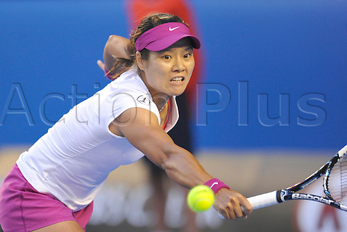 25.01.2014 Melbourne, Australia. Li Na of China plays against Dominika Cibulkova of Slovakia in the ladies singles final on day thirteenth of the Australian Open from Melbourne Park. Li Na powered to the title by a score of 7-6 (7-3) 6-0.