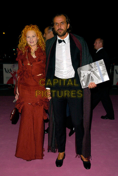VIVIENNE WESTWOOD & ANDREAS KRONTHALER.Leaving the V & A Golden Age of Couture Gala Victoria and Albert Museum, London, England. .September 18th, 2007 .full length medusa red coat dress holding hands shoes black tuxedo care grey gray cape pumps .CAP/CAN.©Can Nguyen/Capital Pictures