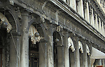 Gargoyles and statues, St Marks square Venice, Italy. columns,grey stone, pidgeon waste,worn weathered stone,sculpture,