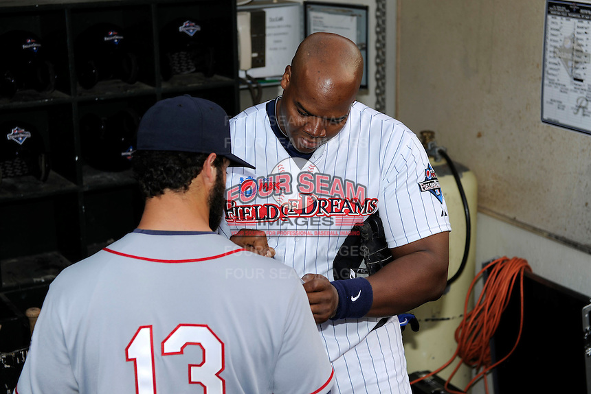 Former Chicago White Sox first baseman Frank Thomas #35 signs the jersey of former minor leaguer David Convertini #13 after the MLB Pepsi Max Field of Dreams game on May 18, 2013 at Frontier Field in Rochester, New York.  (Mike Janes/Four Seam Images)