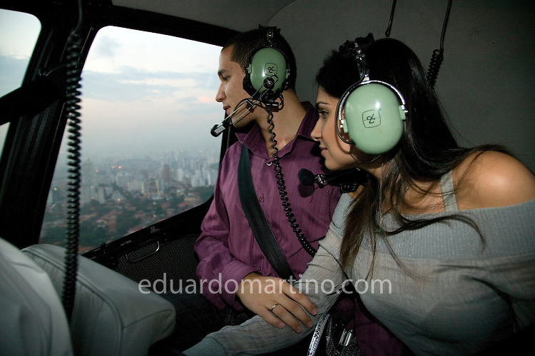 A young couple flies over Sao Paulo for 17 minutes, landing on Sofitel's helipad. They will then have a special dinner and a romantic night at the hotel. This service, called Night Air is one of the many types of helicopter use becoming increasingly popular in Sao Paulo.