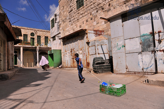 A child drags bottles of water from a mosque in Hebron, West Bank...Photo by Matt Cashore/University of Notre Dame
