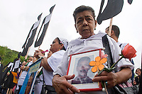 A woman shows a sign with a picture of her missing son in commemoration of the National Movement of Victims of State Crimes, MOVICE, commemorate this April 9 as the Day of Memory and Solidarity with Victims of state crimes in this time of vital importance to the country because it was from when triggered, significantly, the political conflict, social and armed, that today, after decades, continues in the form of persecution, threats and harassment against land claimants leaders and human rights defenders. In the district there are 13 mass graves containing more than 1000 dead buried in a dump that works in the area. The close calls that dump MOVISE and declare the area as a cemetery. In Colombia, this time away from a transitional or post. More than 60 leaders killed lands (at least 26 of these victims killed between 2010 and 2011), the reengineering of paramilitarism in over 400 municipalities, more than 1,400 displaced people killed since 2007, a development model based on dispossession and displacement. In Medellín, Colombia. 09/04/2012. Photo by Fredy Amariles/VIEWpress.