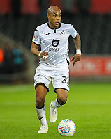 29th November 2019; Liberty Stadium, Swansea, Glamorgan, Wales; English Football League Championship, Swansea City versus Fulham; Andrew Ayew of Swansea City brings the ball forward during the match - Strictly Editorial Use Only. No use with unauthorized audio, video, data, fixture lists, club/league logos or 'live' services. Online in-match use limited to 120 images, no video emulation. No use in betting, games or single club/league/player publications