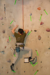 Climbing competition for kids with adult supervision at Vail Athletic Club, Vail, Colorado, USA
